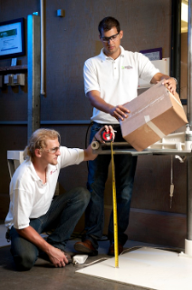 Jason Hoepker (left) and Assistant Professor Laszlo Horvath evaluate the ability of a shipping container to survive multiple drops during distribution.