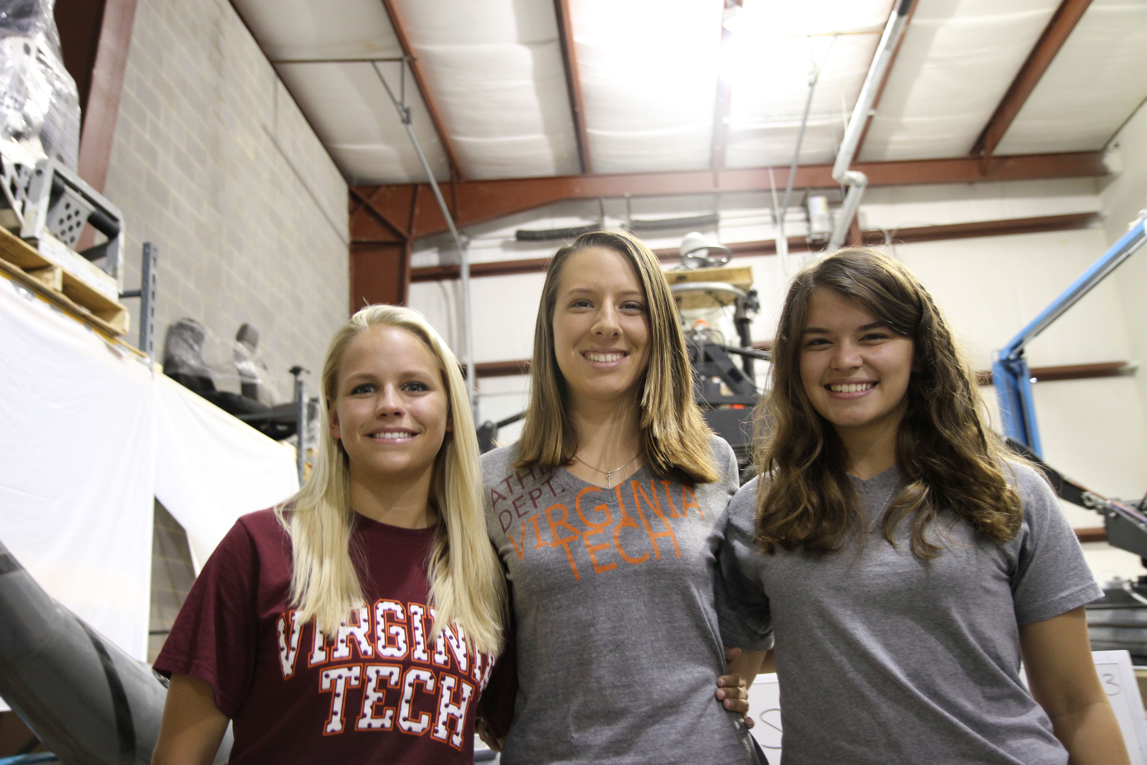 Alisha Konst and Robin Roston, both rising juniors in mechanical engineering at Virginia Tech, and Alison Brown, a rising sophomore in electrical engineering at Virginia Western Community College, meet at Virginia Tech's Center for Vehicle Systems and Safety Lab.