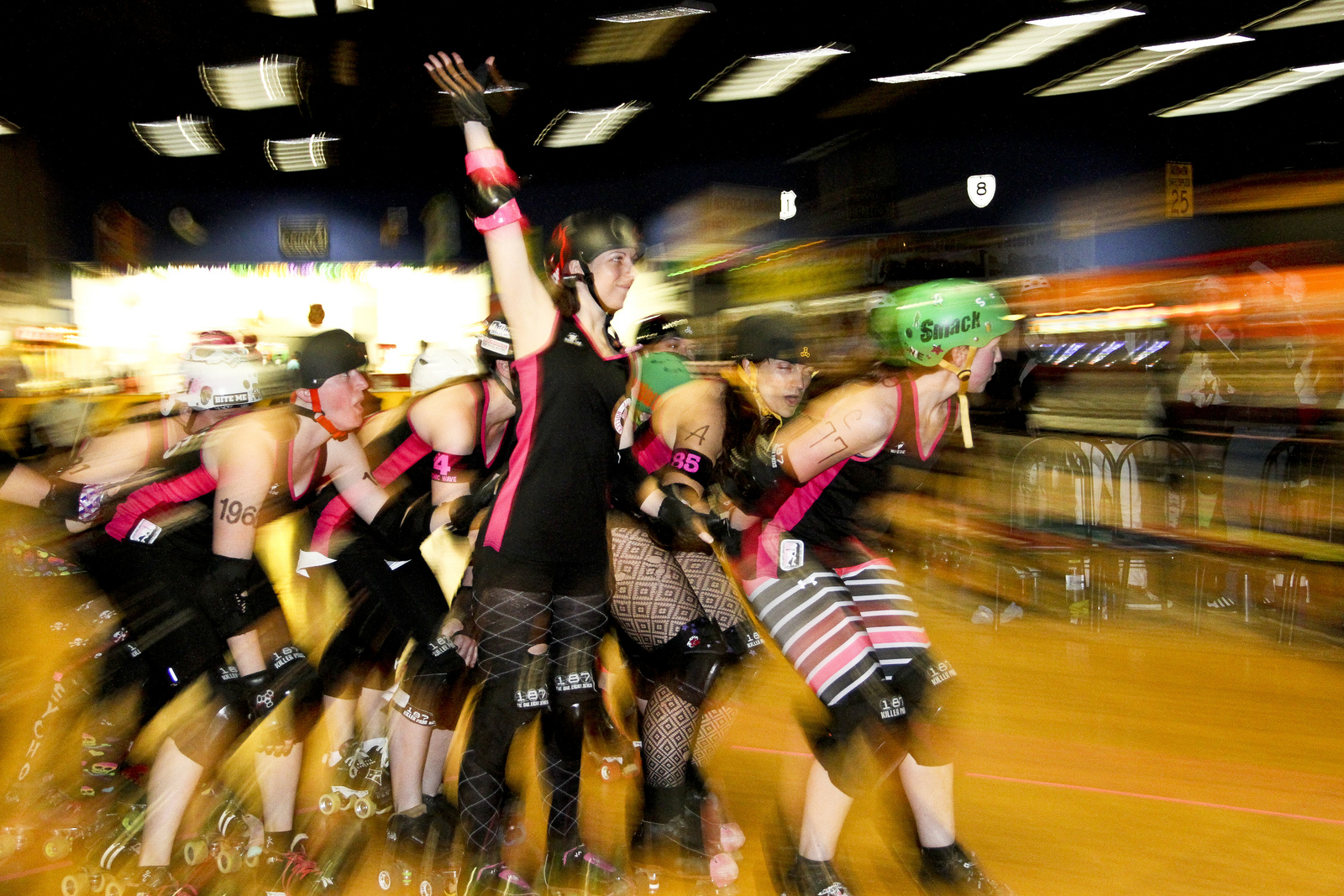 The Virginia Tech Roller Derby Club takes a victory lap. Photo by Suzanne Locascio.
