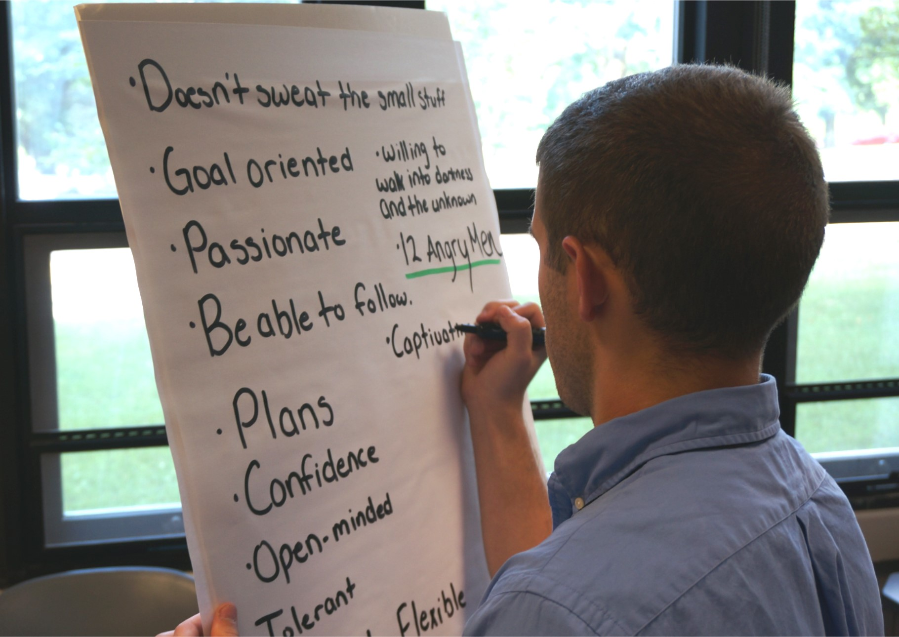 Austin Sears, of Manassas, Va., works on a leadership attributes exercise during a Pamplin program on campus this summer.