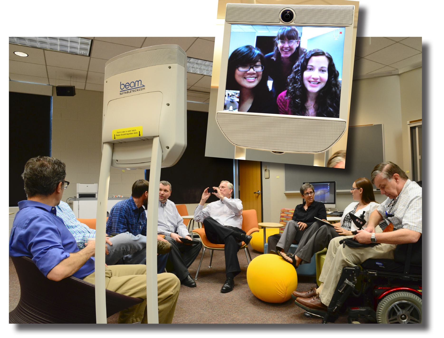 Students, staff, and faculty collaborate with offsite participants using a mobile videoconferencing device.