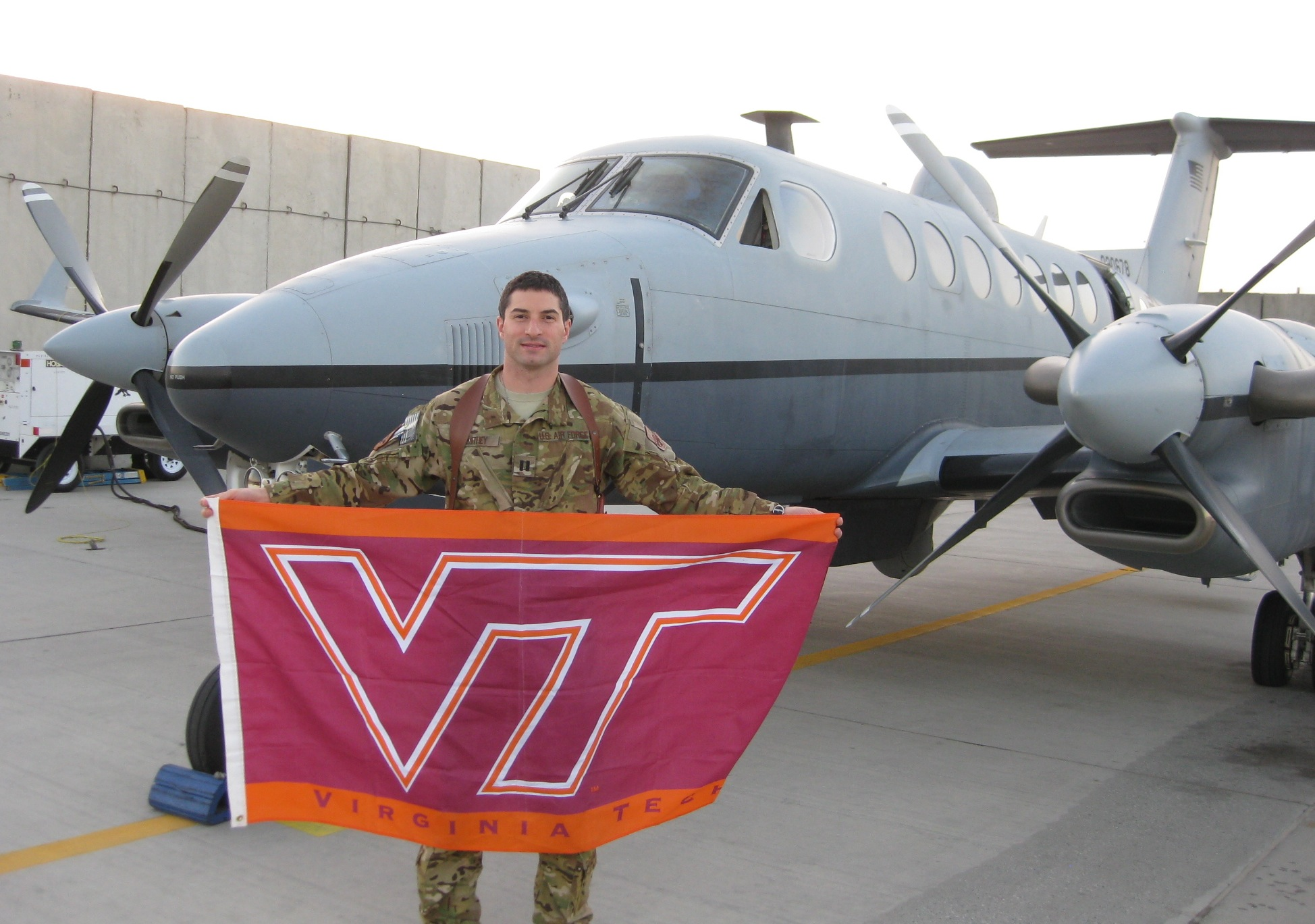 Capt. Andrew Smithey, U.S. Air Force, Virginia Tech Corps of Cadets Class of 2007 in front of his aircraft