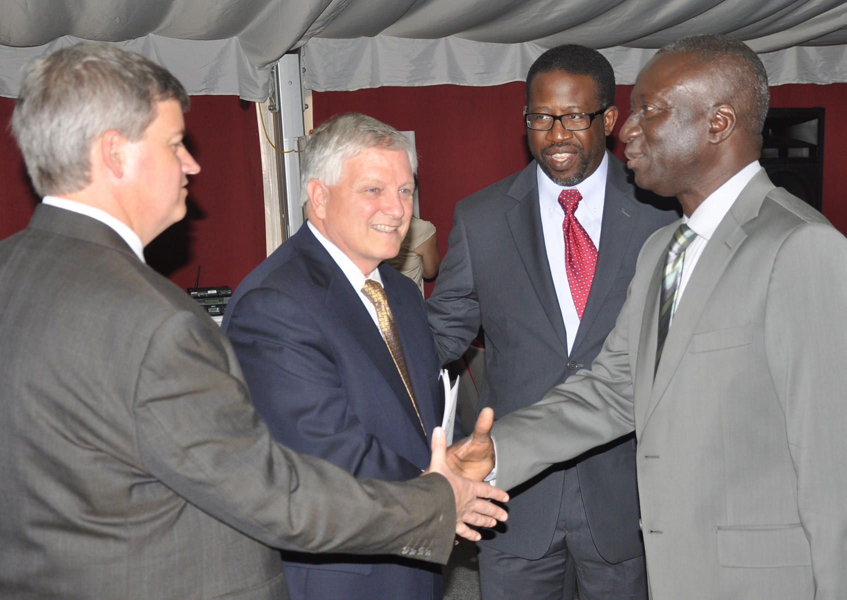 Virginia Tech official shakes hands with manager general of higher education in Senegal