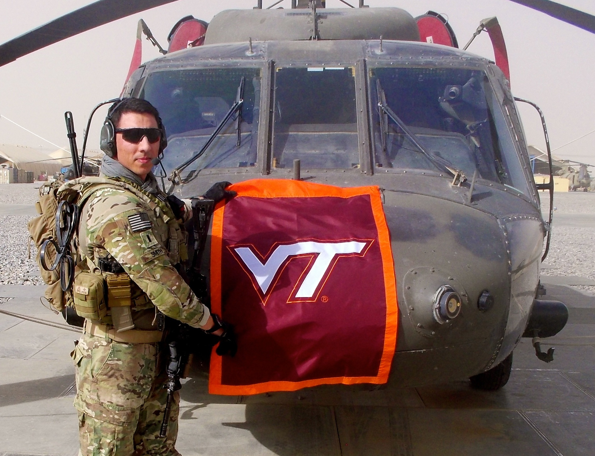 1st Lt. Matthew Smith, U.S. Army, Virginia Tech Corps of Cadets Class of 2011 in front of his helicopter.