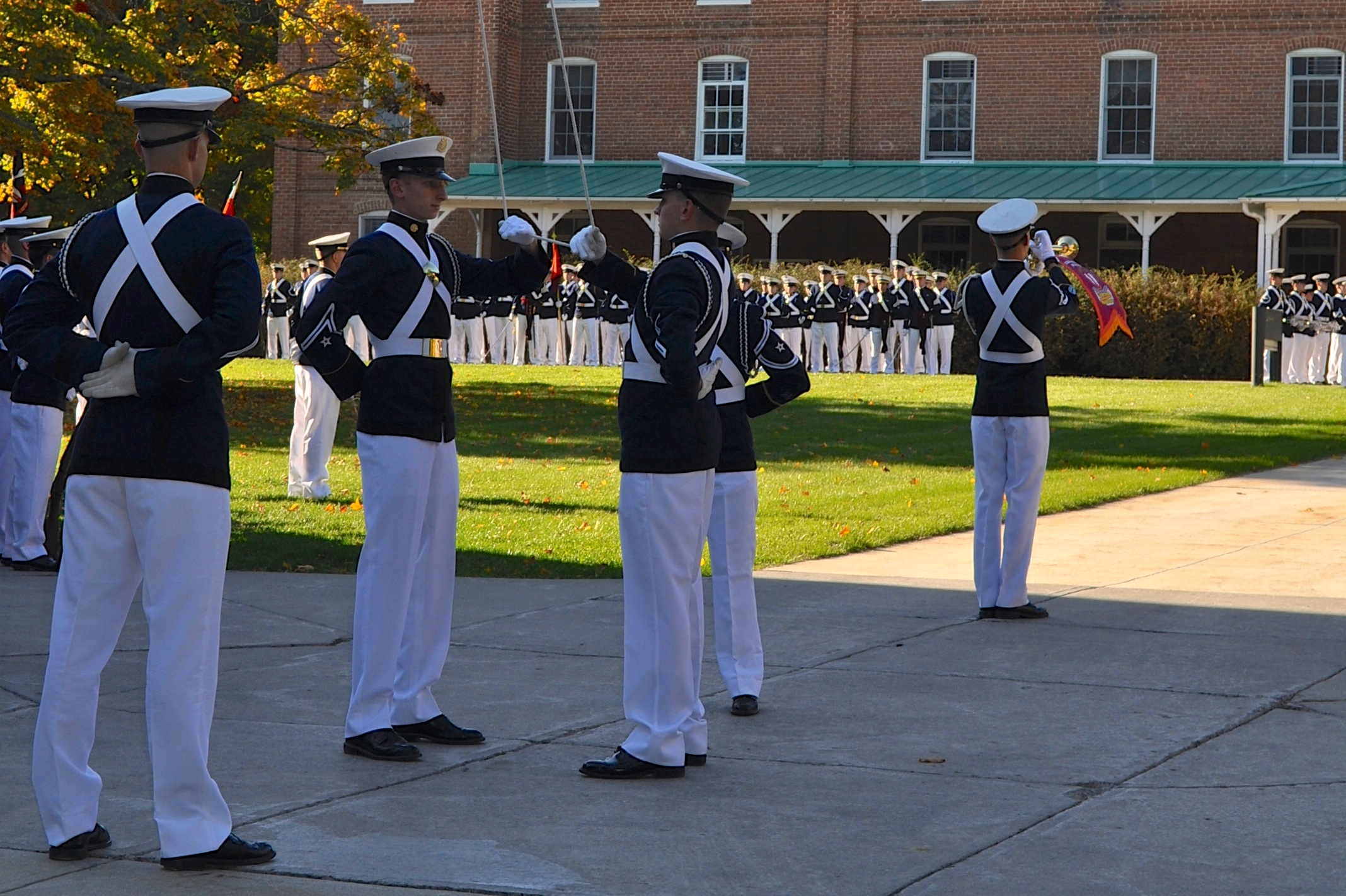The Virginia Tech Corps of Cadets honor the colors during a formal retreat ceremony on the Upper Quad.