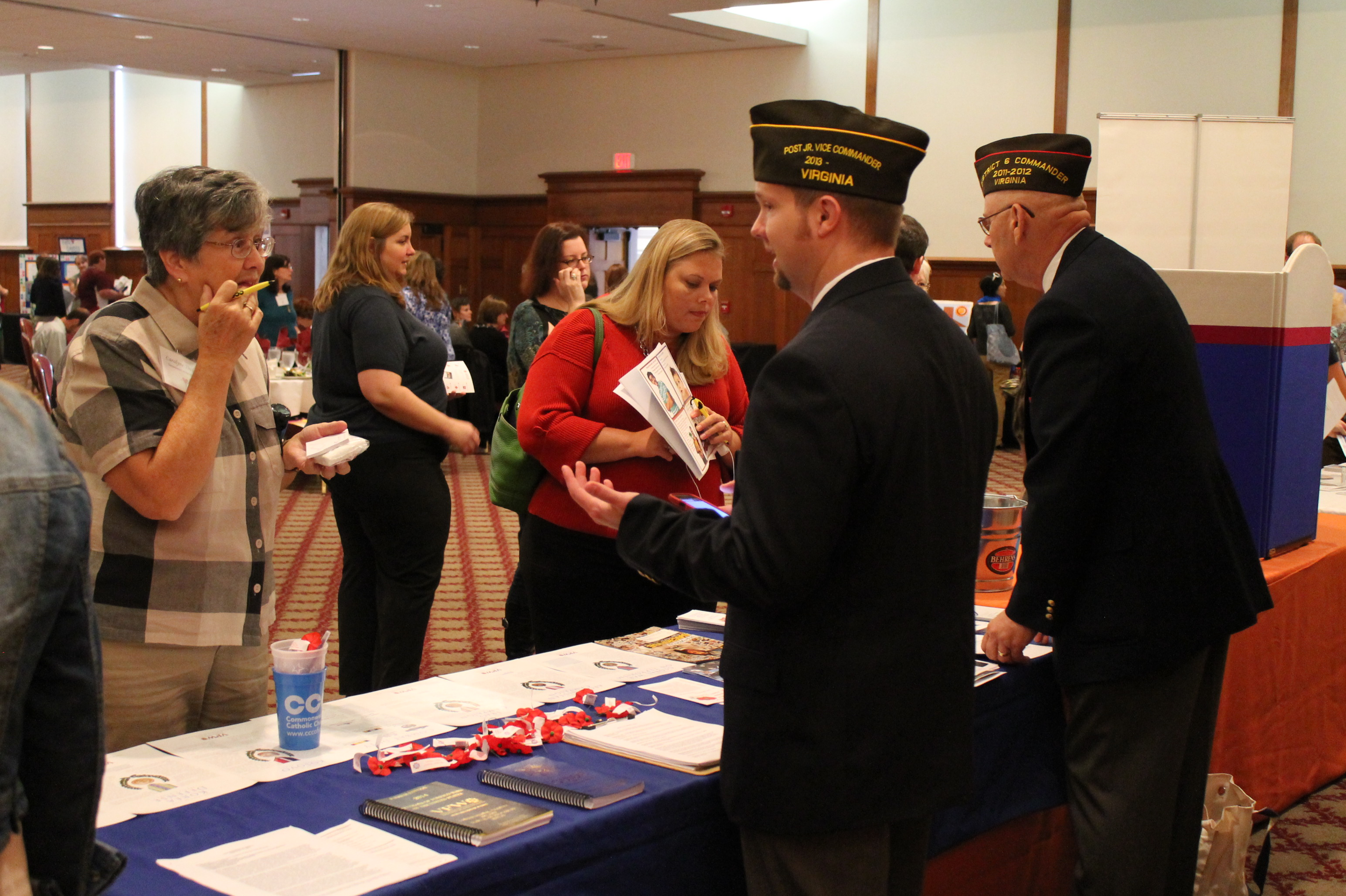 Representatives from the Veterans of Foreign Wars speak with guests at the Sept. 25, 2013, Commonwealth of Virginia Kick-off Luncheon.
