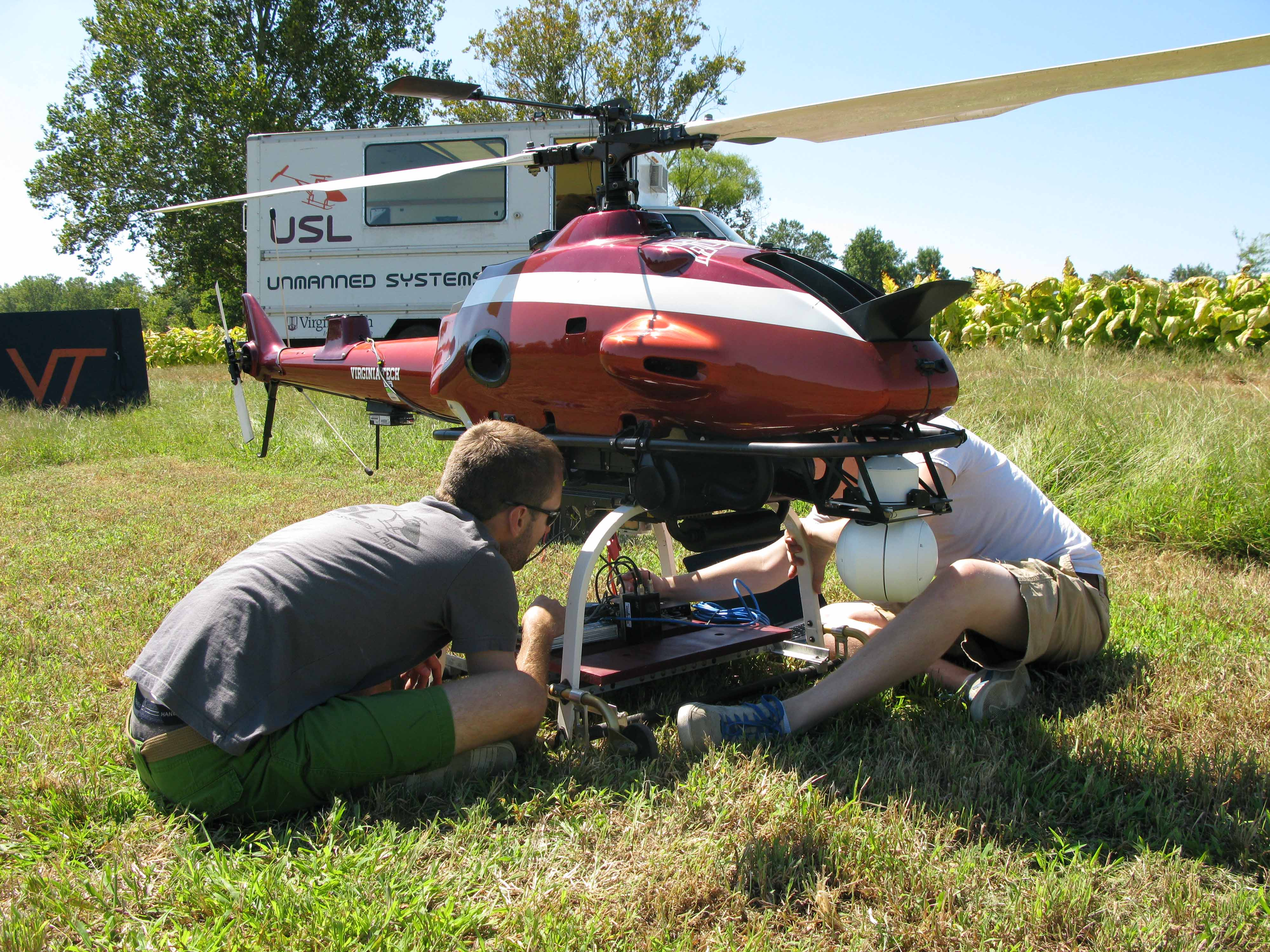 Mechanical engineering students prepare a helicopter for a research mission.