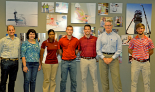 (Left to right) Andrew McCoy, Parisa Nikkhoo, Iman Elrayah, Ryan Piplico, Jeff Bonica, Chris Brandt, and Zach Wegryn at a subcontractor pre-construction conference at Hourigan Construction's Hampton Roads Office.