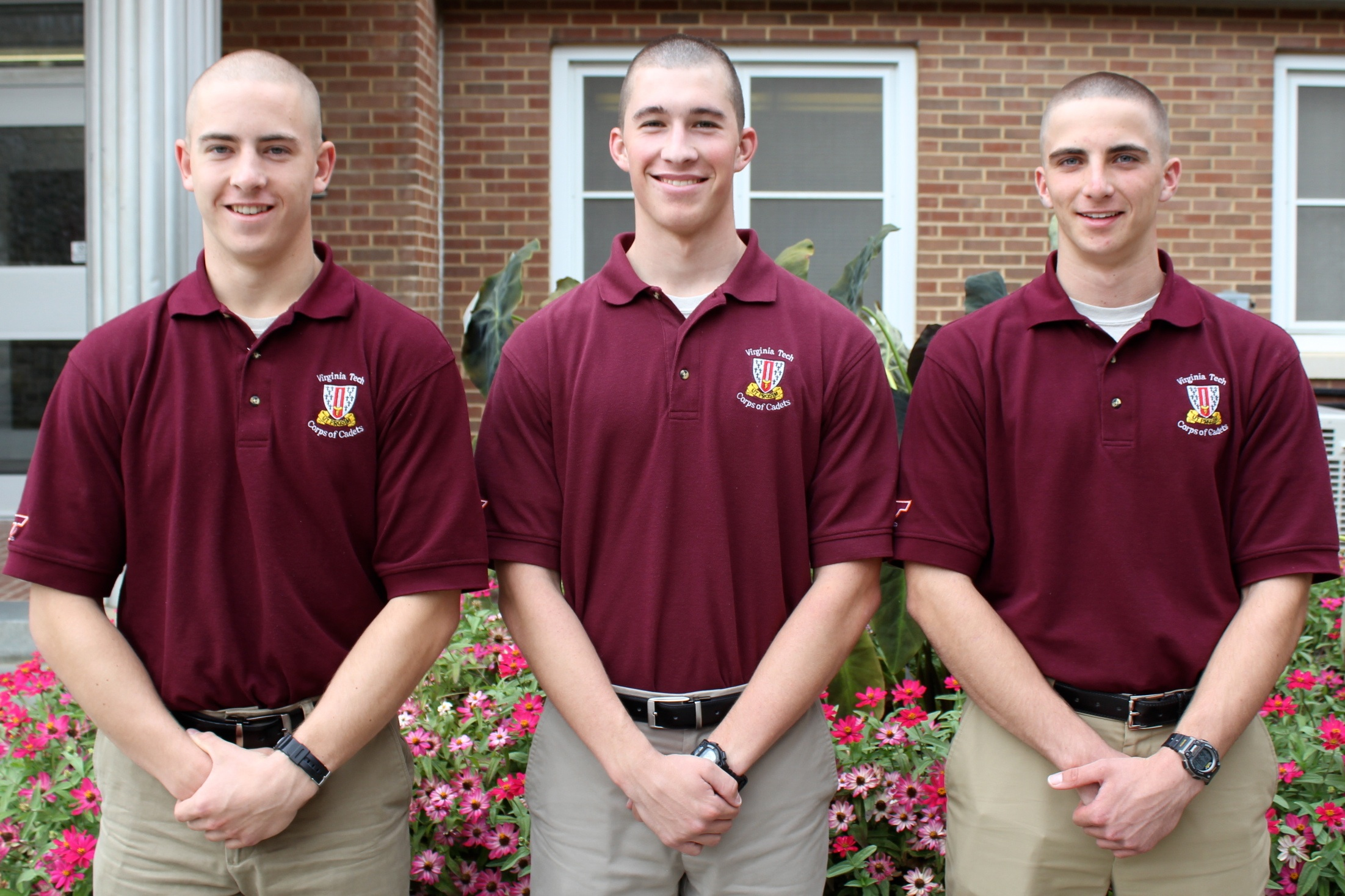 From left to right are Cadets Andrew Bergman, Richard Daum, and Andrew Greenwood standing in front of Brodie Hall.