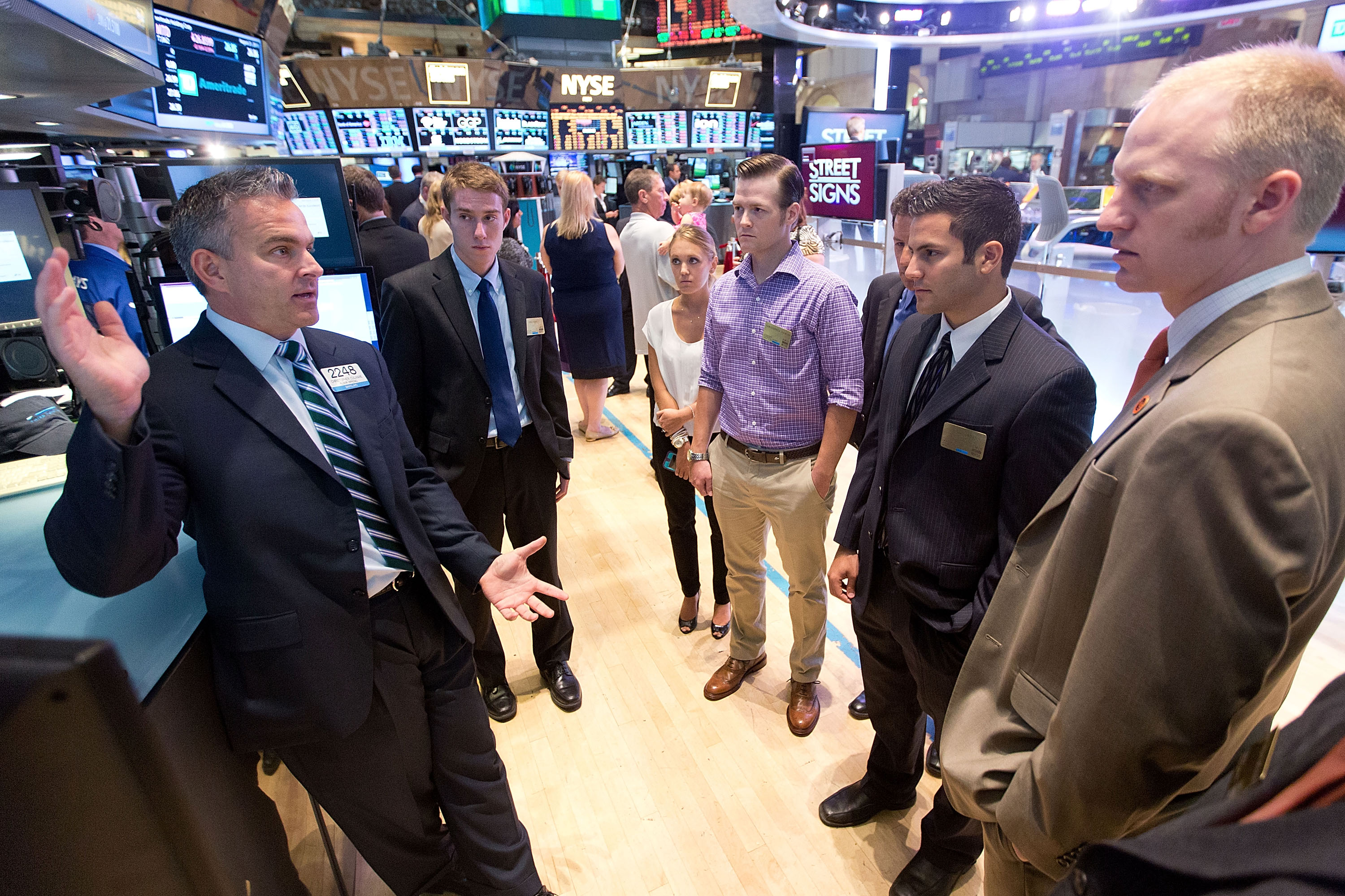 Eric Siss (second from left) and other scholarship winners listen to a floor trader during a tour of the New York Stock Exchange.