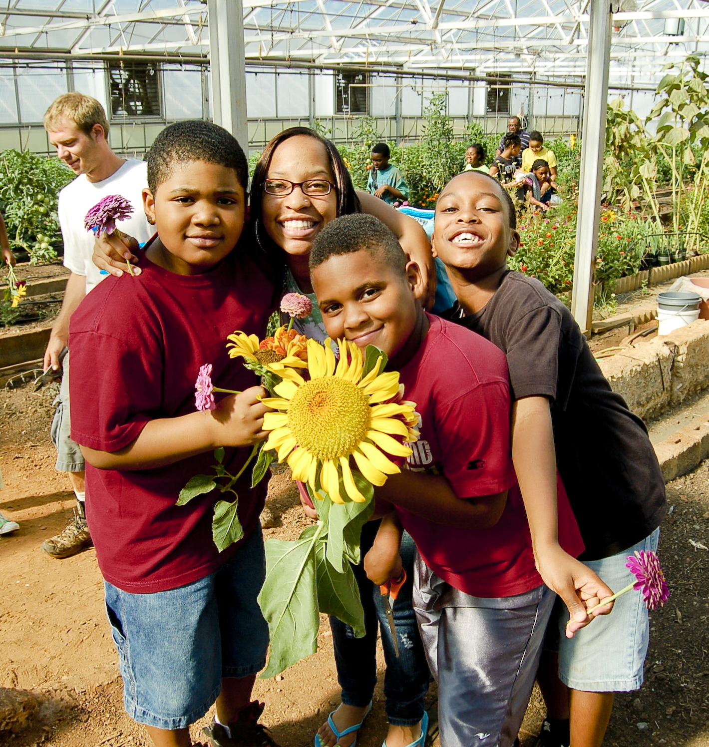 Children with sunflower.