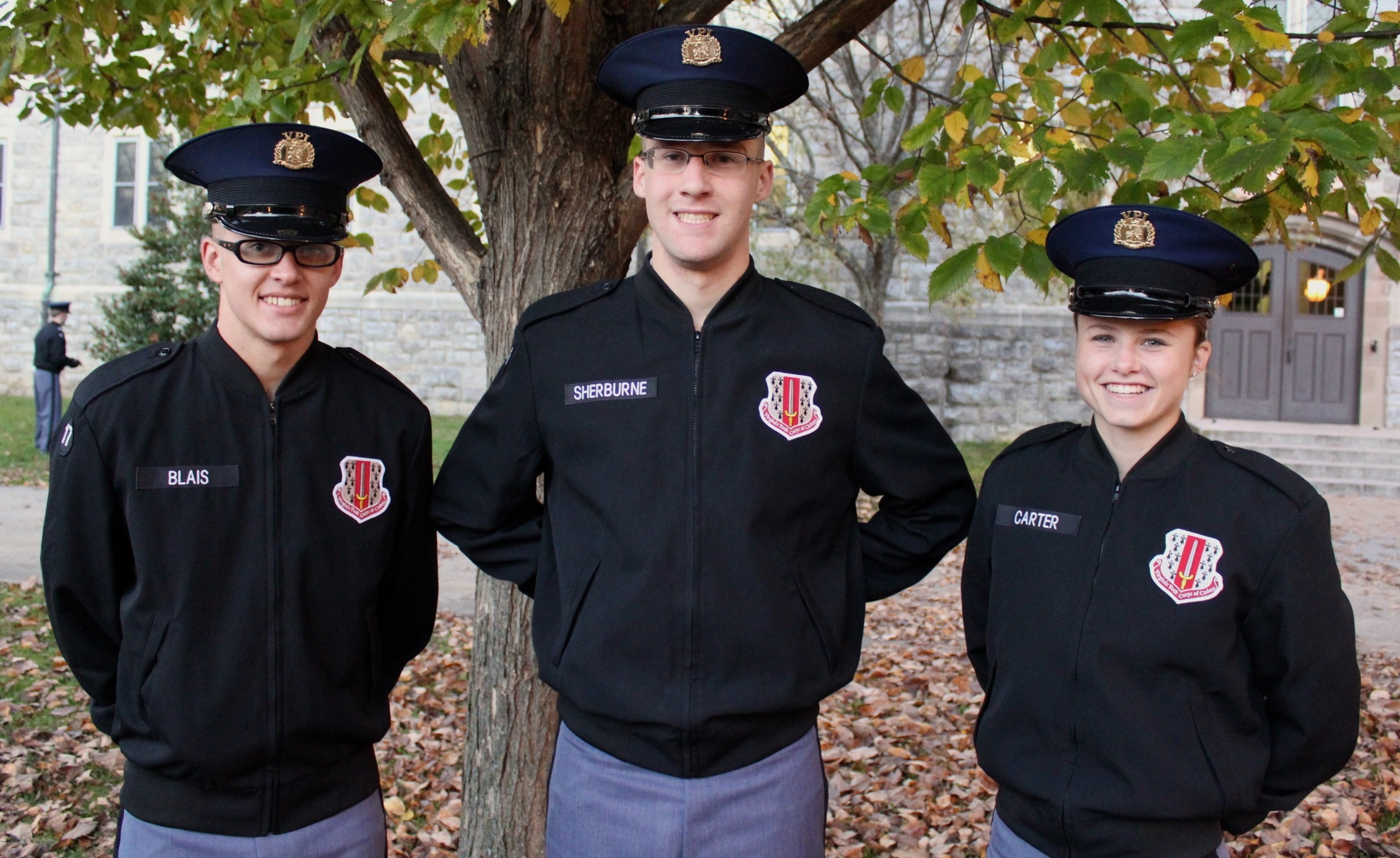 From left to right are Cadets Chas Blais, Michael Sherburne, and Amanda Carter in the Eggleston Quad.