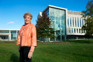 Patricia Buckley Moss stands outside the Moss Arts Center at Virginia Tech.