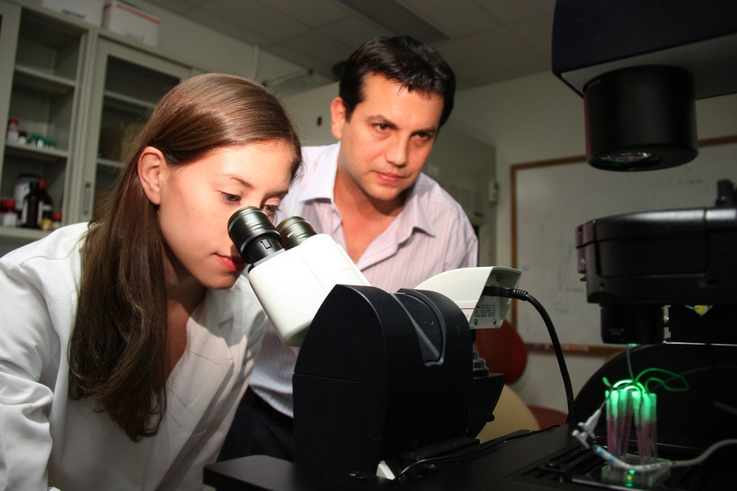Elisa Wasson examines a sample through a microscope