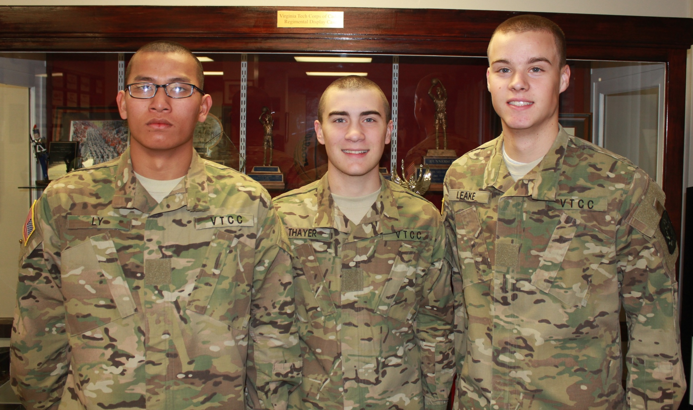 Cadets Tau Be Ly, Michael Thayer, and Austin Leake in Brodie Hall.