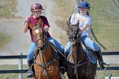 Students Jenny Schwartz and Christine Pankow practice playing polo at the home base of Polo Club at Virginia Tech.