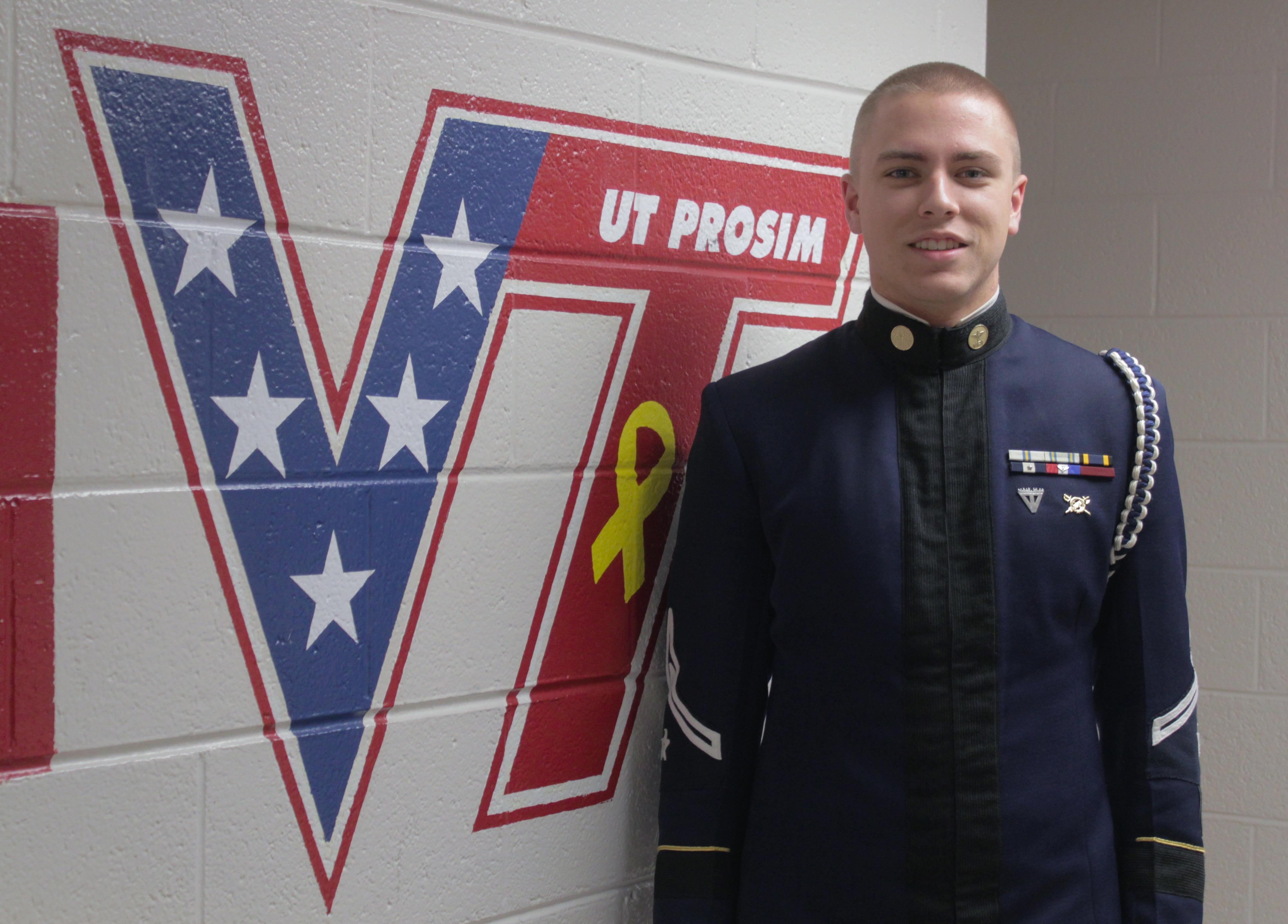 Cadet Christopher Blaney stands in a cadet hallway.