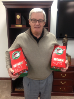 Coach Frank Beamer holds two Operation Christmas Child boxes.