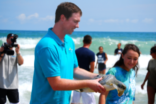 A special turtle release was part of Clark DeHart's final episode as co-host of Aqua Kids.