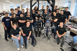 Team THOR, consisting of the Robotics and Mechanisms Laboratory of Virginia Tech and the GRASP robotics team from University of Pennsylvania, pose with the robots, THOR and TJOR-OP. THOR is short for Tactical Hazardous Operations Robot.
