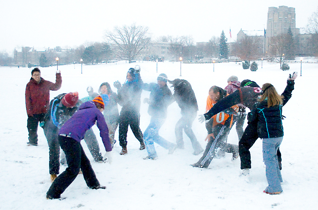 Students engage in a friendly winter snowball fight.