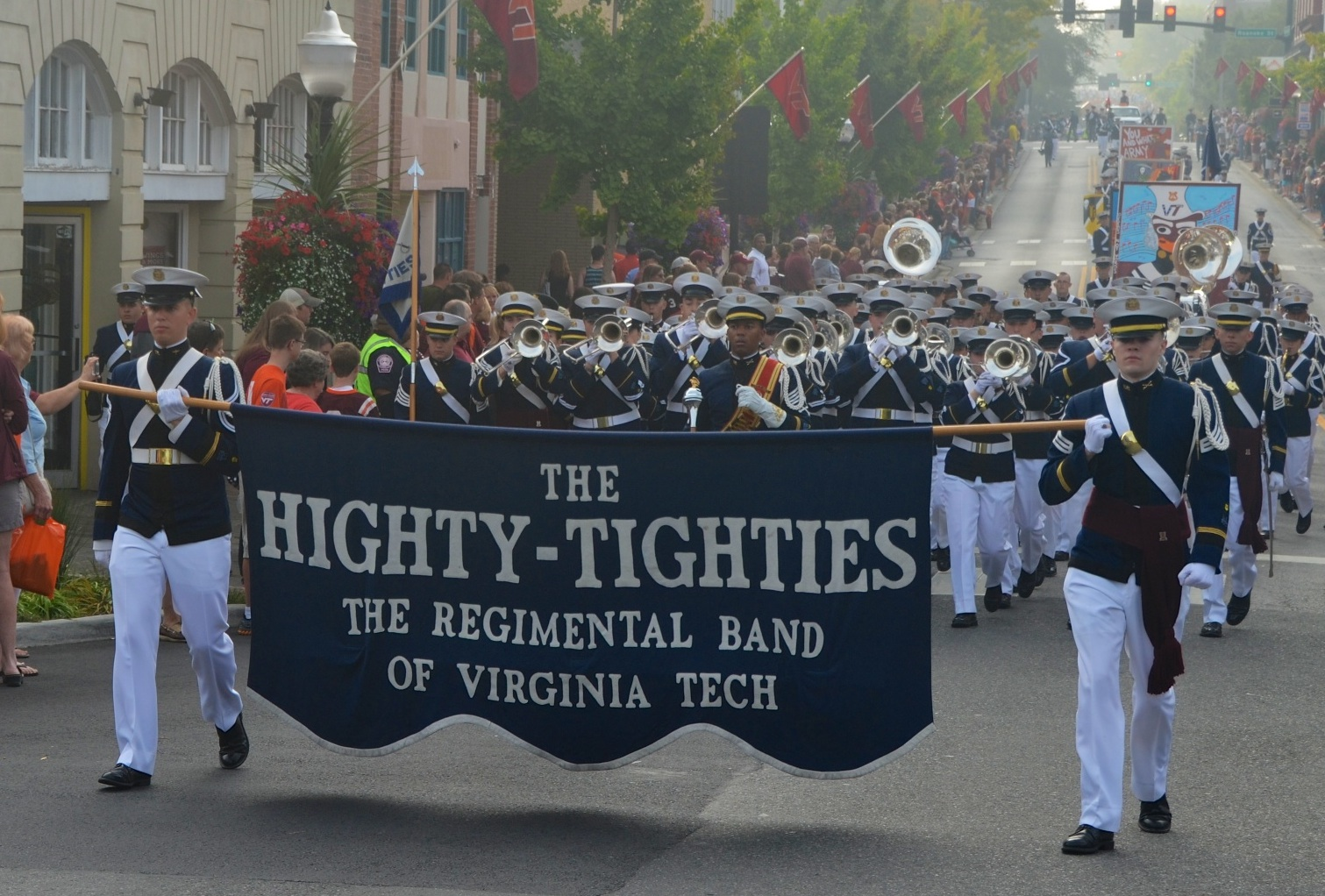 The Highty-Tighties march in a parade in downtown Blacksburg