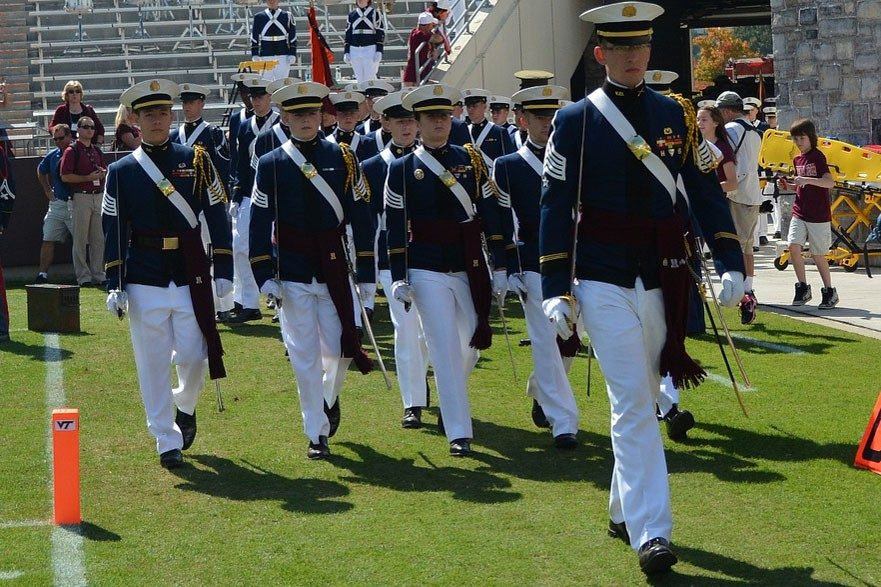 Cadet Jordan Disney leads his 2nd Battalion staff on the Lane Stadium field during a home football game.