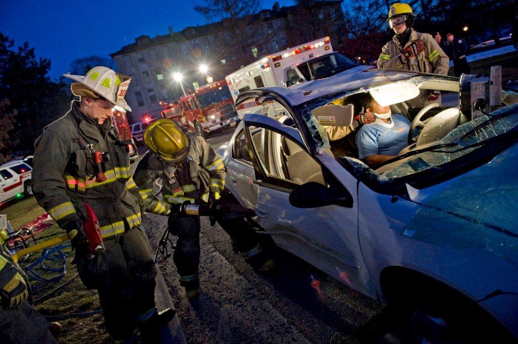 First responders assist victim during simulated motor vehicle collision