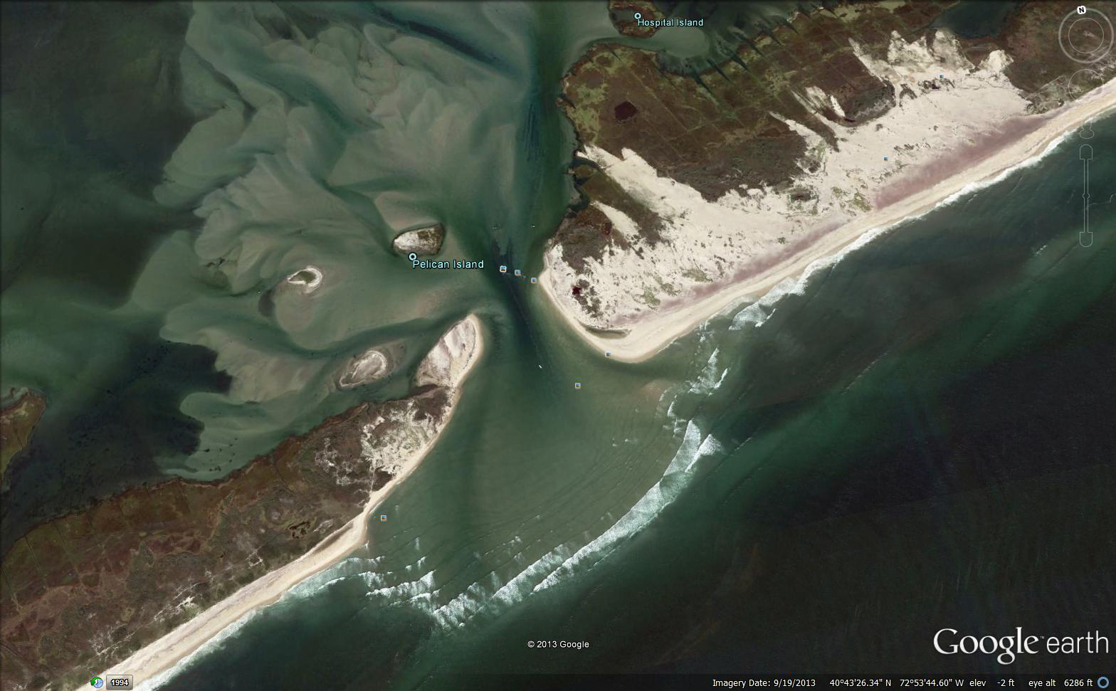This aerial view shows the new inlet on New York's Fire Island and large areas of sand pushed over vegetation by Hurricane Sandy. Image generated from Google Earth.
