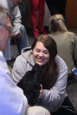 ODU student with a therapy dog