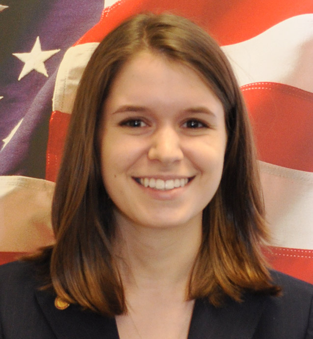 Female student headshot in front of American flag