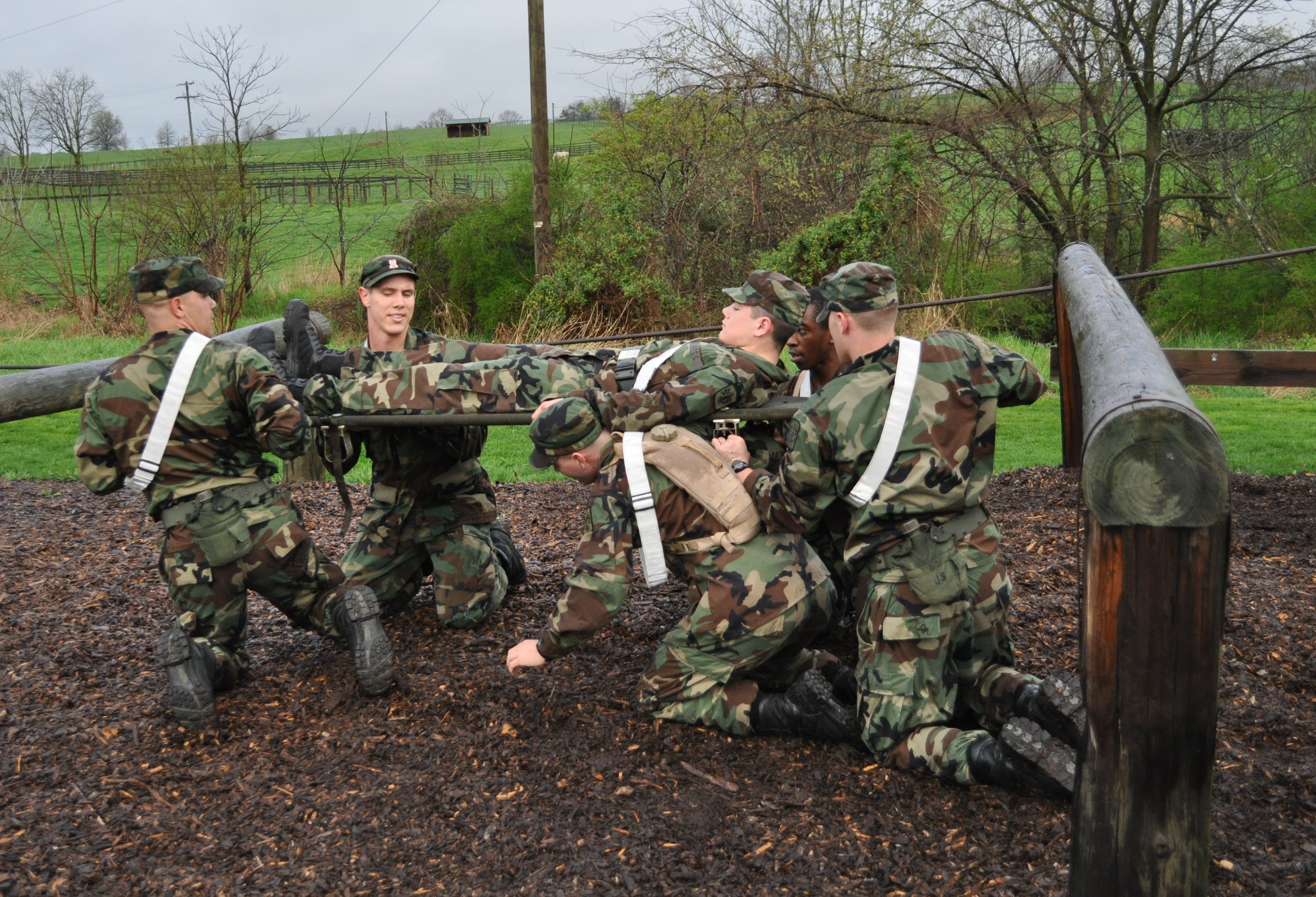 Cadets take part in an event during the Annual Corps Squad Tactical Challenge and carry a cadet via litter over the obstacle course