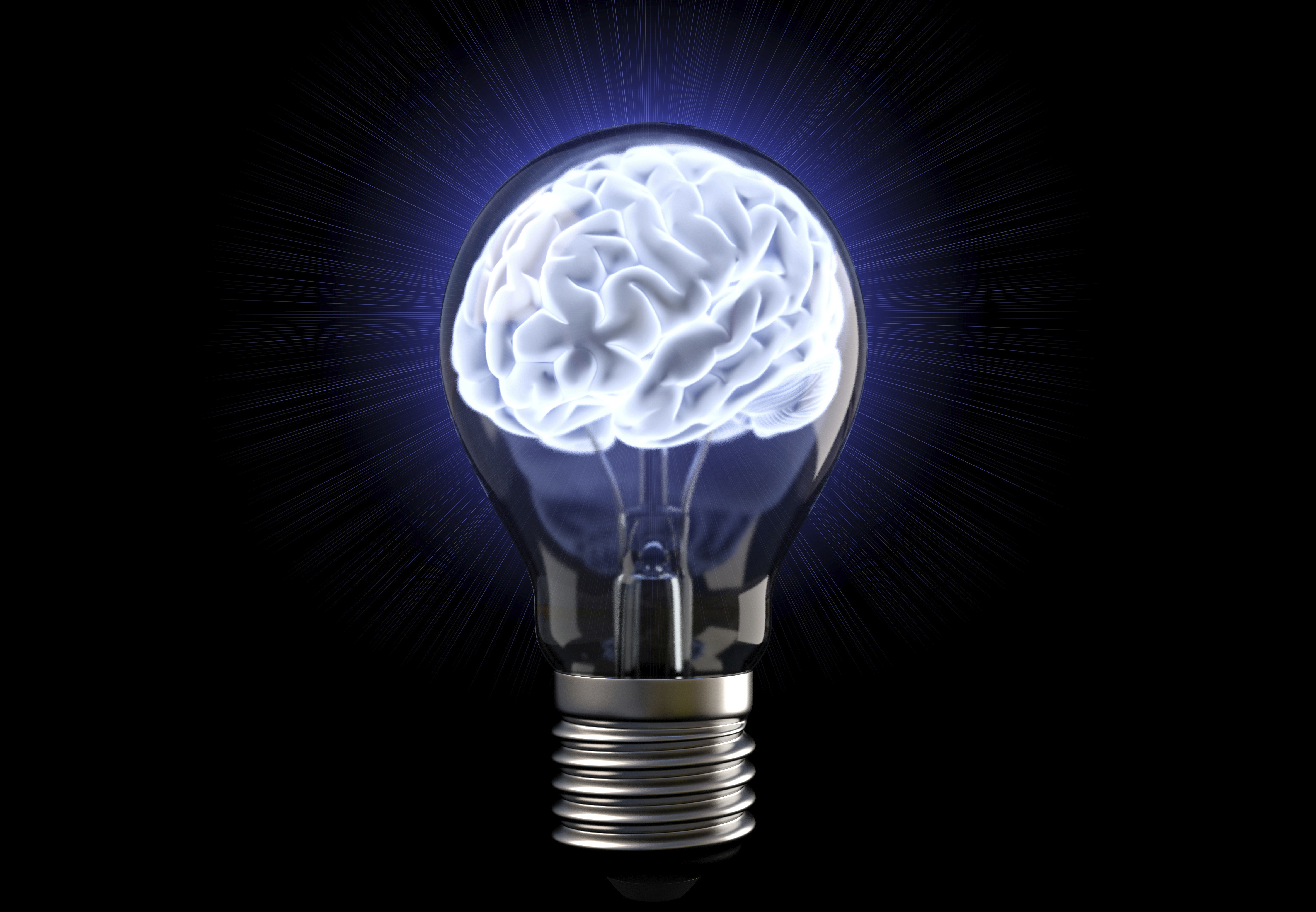 A lightbulb encases a glowing brain