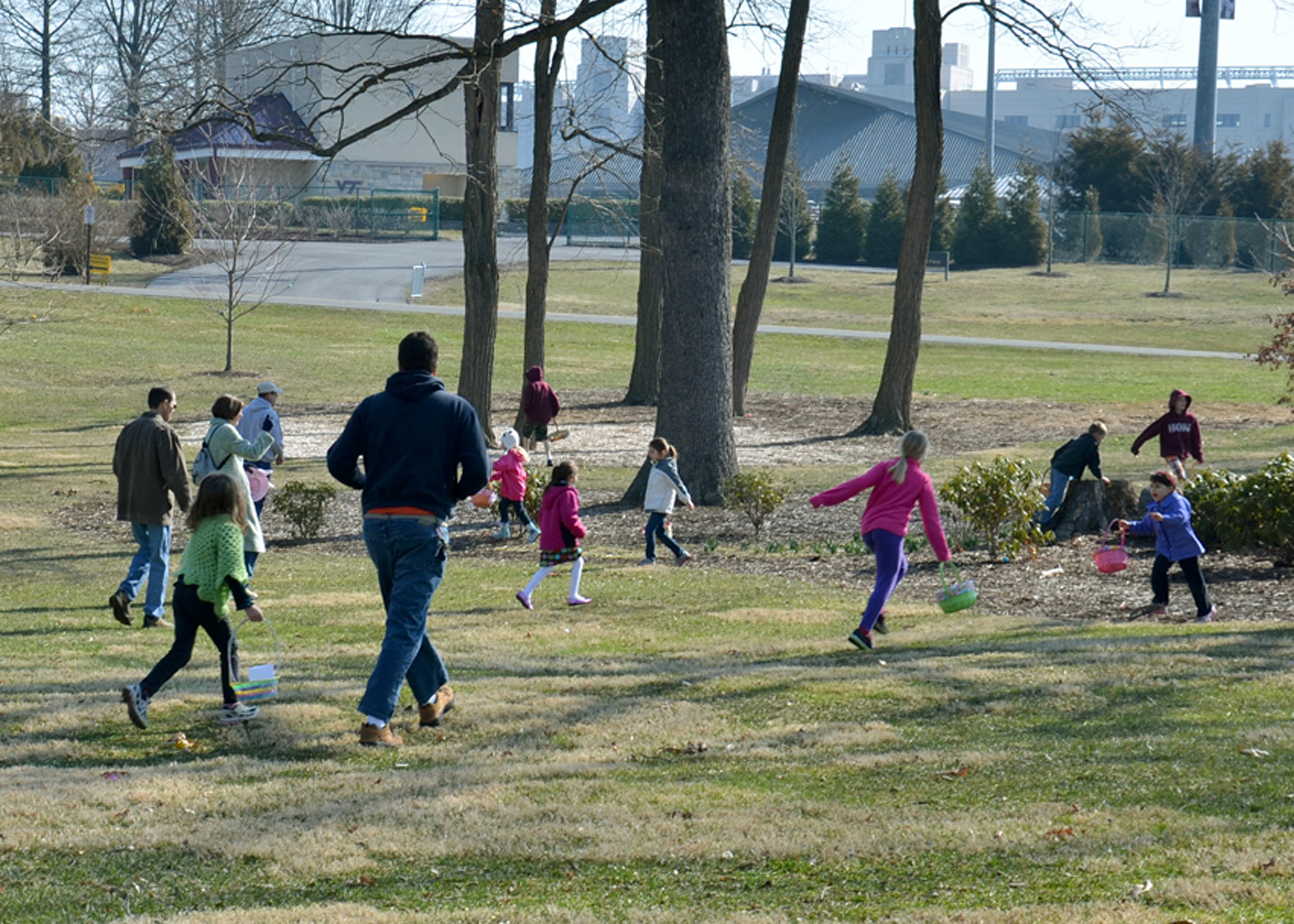 Children search for eggs in the veterinary college's historic oak grove. The annual Easter egg hunt is free and open to the public.