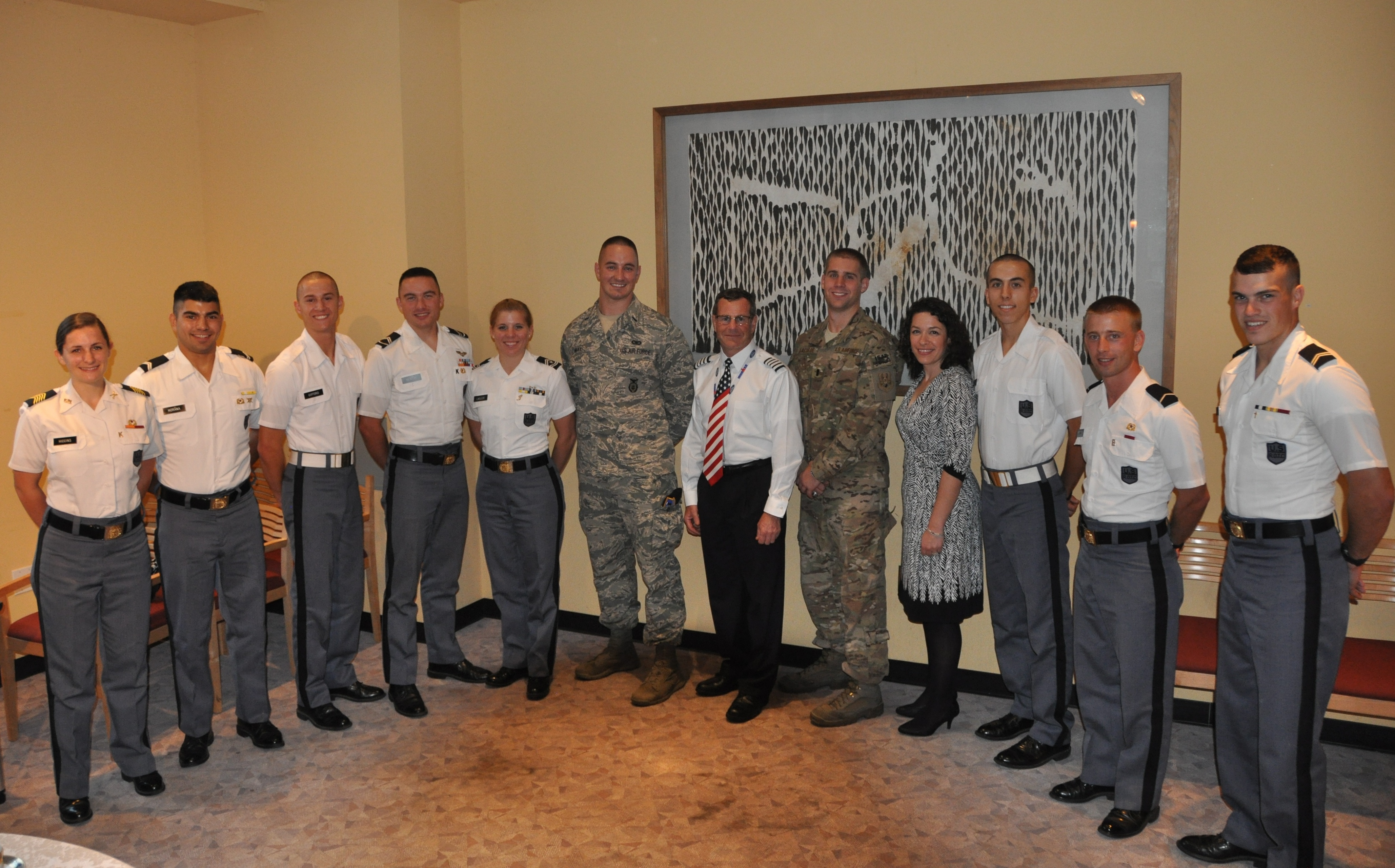 Cadets stand with the visiting Fall 2013 Gunfighters at the reception following the panel.