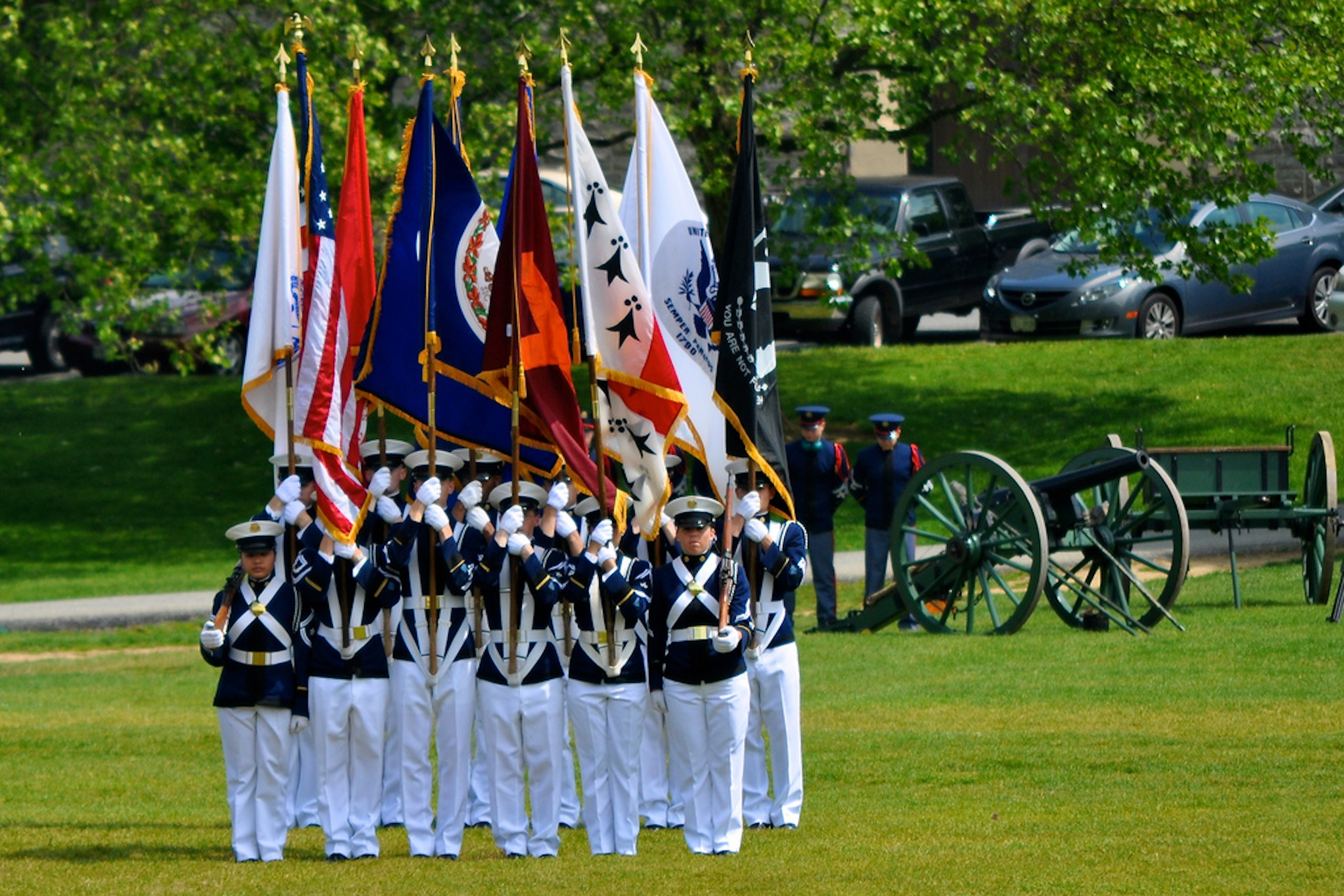 The Virginia Tech Corps of Cadets Color Guard and cannon, Skipper, prepare for the start of a parade on the Drillfield.