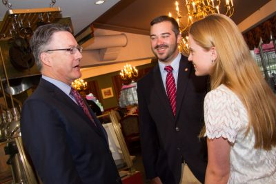 Timothy Sands talks with Brent Ashley, outgoing SGA president, and Elizabeth Lazor, incoming SGA president.