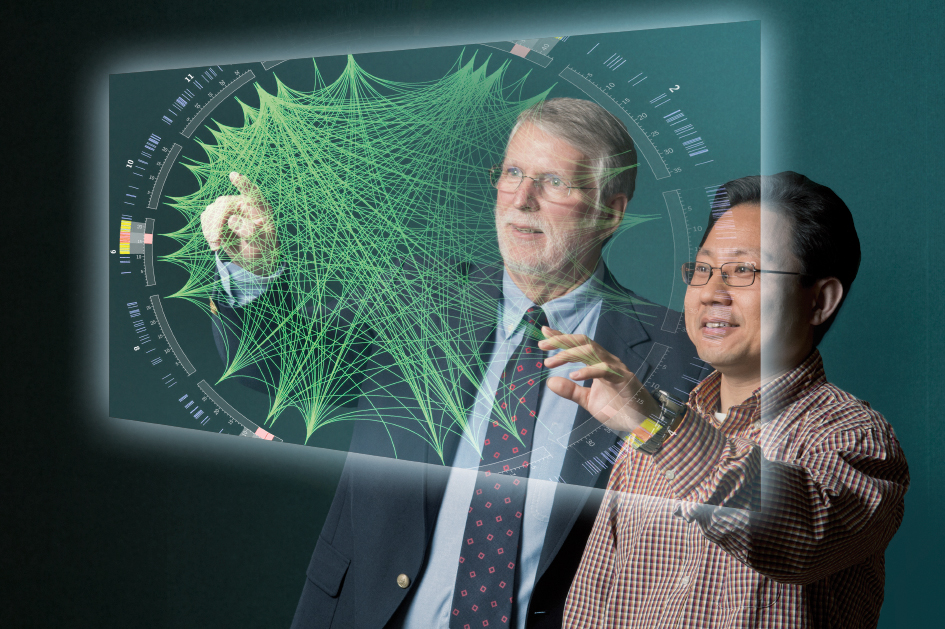A blended image showing Pamplin faculty members Terry Rakes (left) and Patrick Fan with a computer generated visualization of data related to genome mapping. The Center for Business Intelligence and Analytics seeks to be an interdisciplinary resource in the growing field of big data.