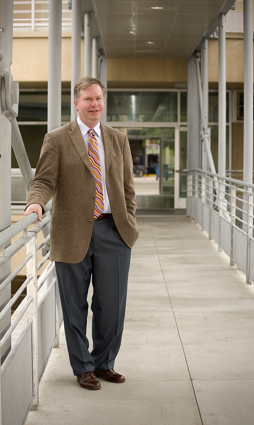 Henri deHahn stands on a covered walkway.