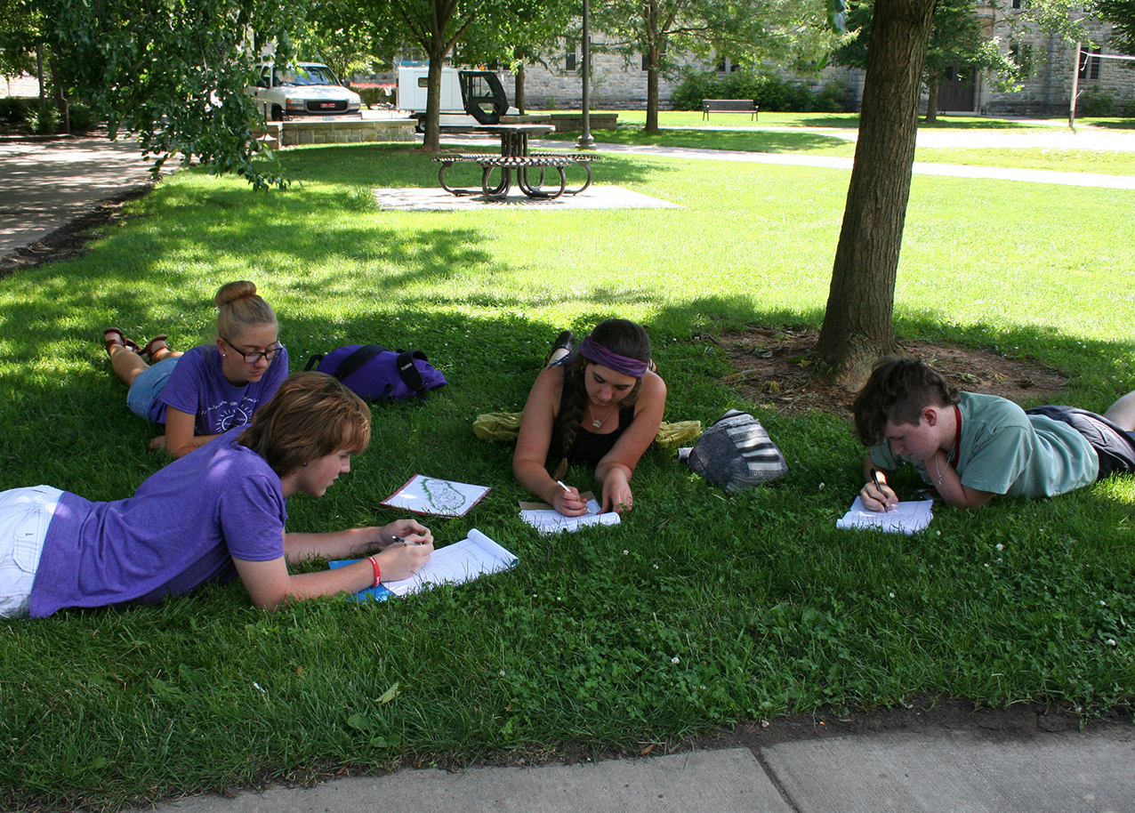 Students outdoors participate in last year's All Write workshop.