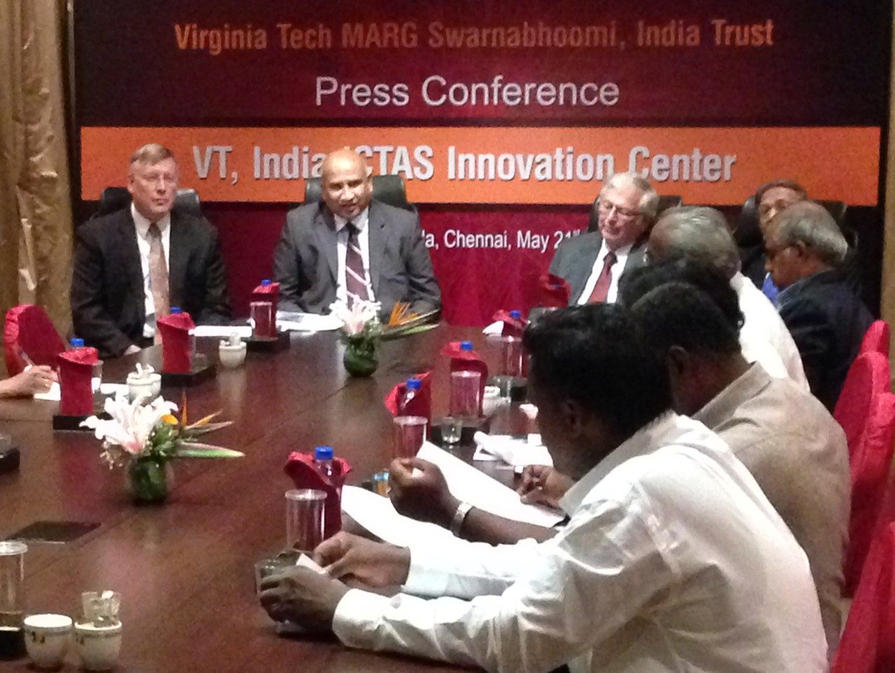 Reporters interview leadership from Virginia Tech and its Indian partner, MARG, at a news conference today in Chennai, India, announcing the opening of VT, India ICTAS Innovation Center.  Pictured at end of the table, left to right, are Richard Benson, dean of the College of Engineering at Virginia Tech; G.R.K. Reddy, MARG president; and Virginia Tech President Charles Steger.