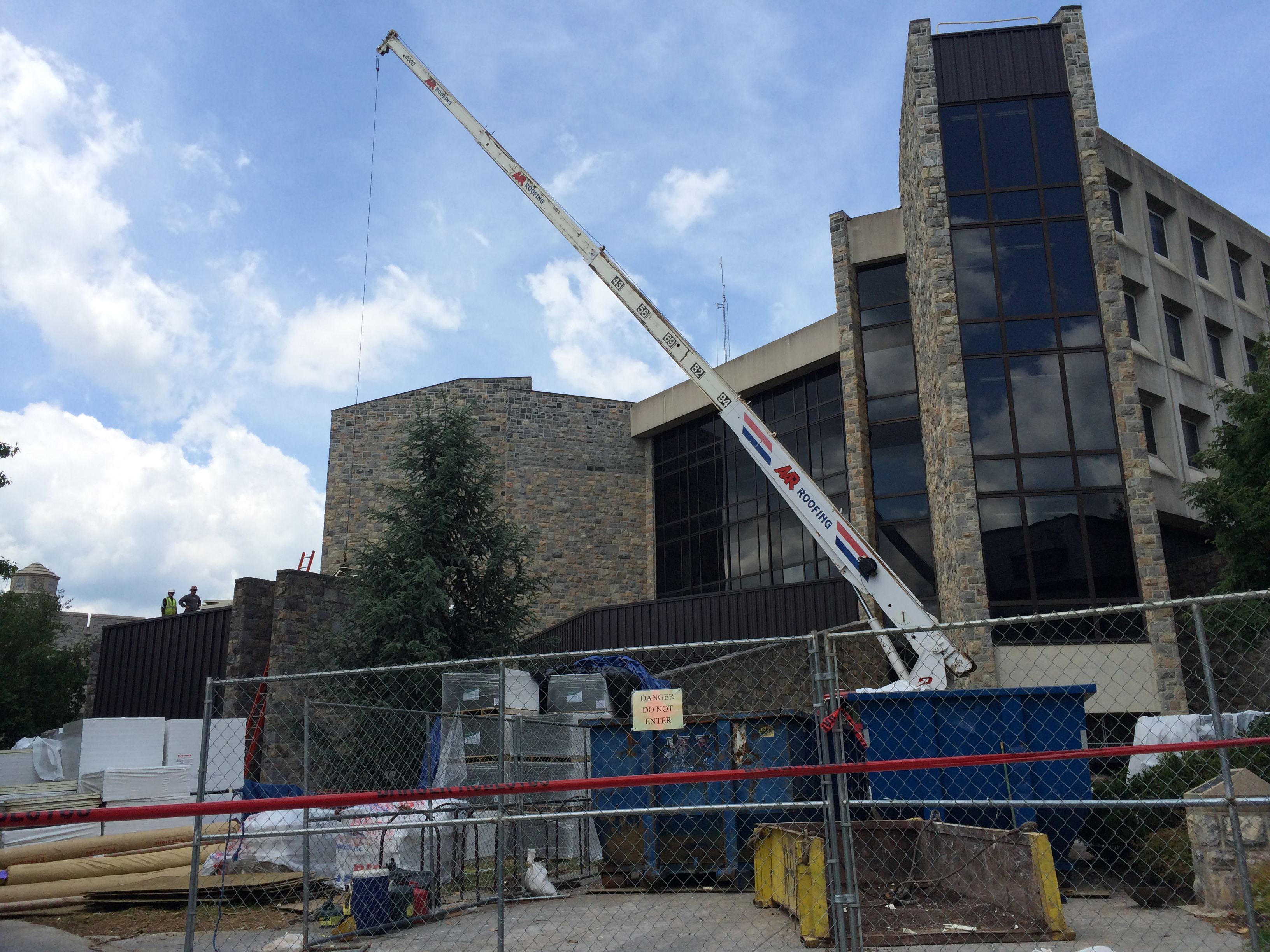Crane hauling materials for McBryde Hall roof project