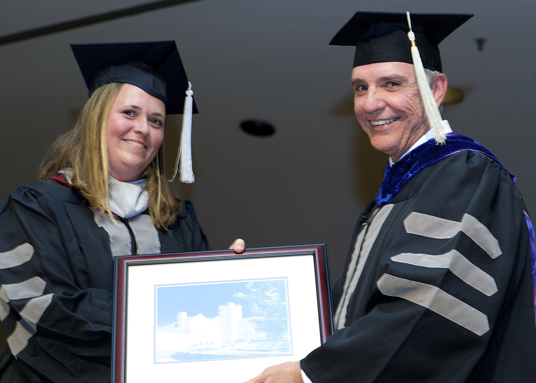 Dr. Melinda McCall with the college dean