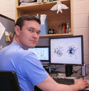 Doctoral student Alexander Silvis looks at Indiana bat roost network maps.