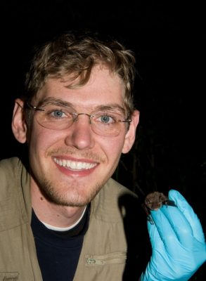 Andrew Kniowski holding an Indiana bat
