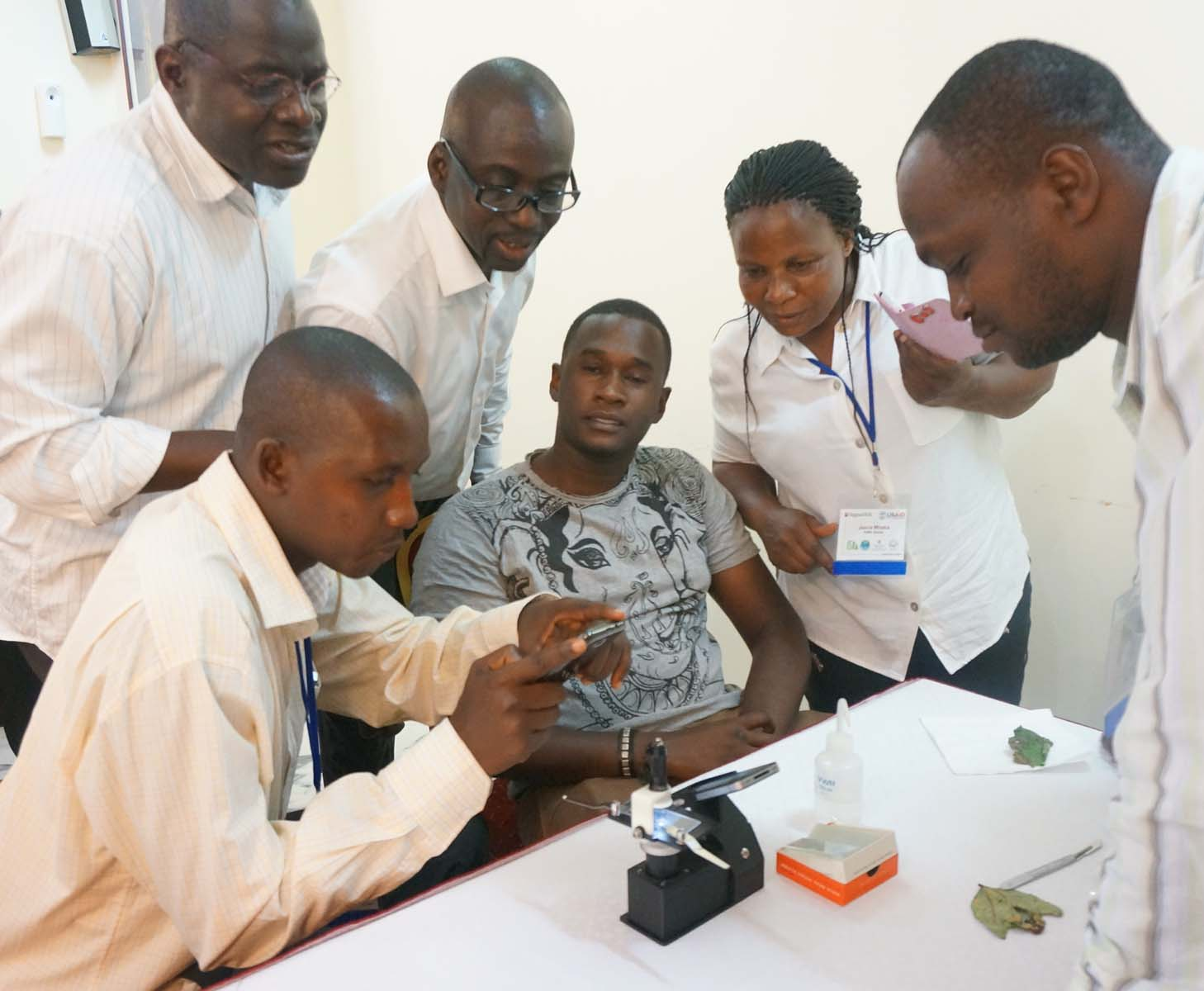 African scientists examine microscope
