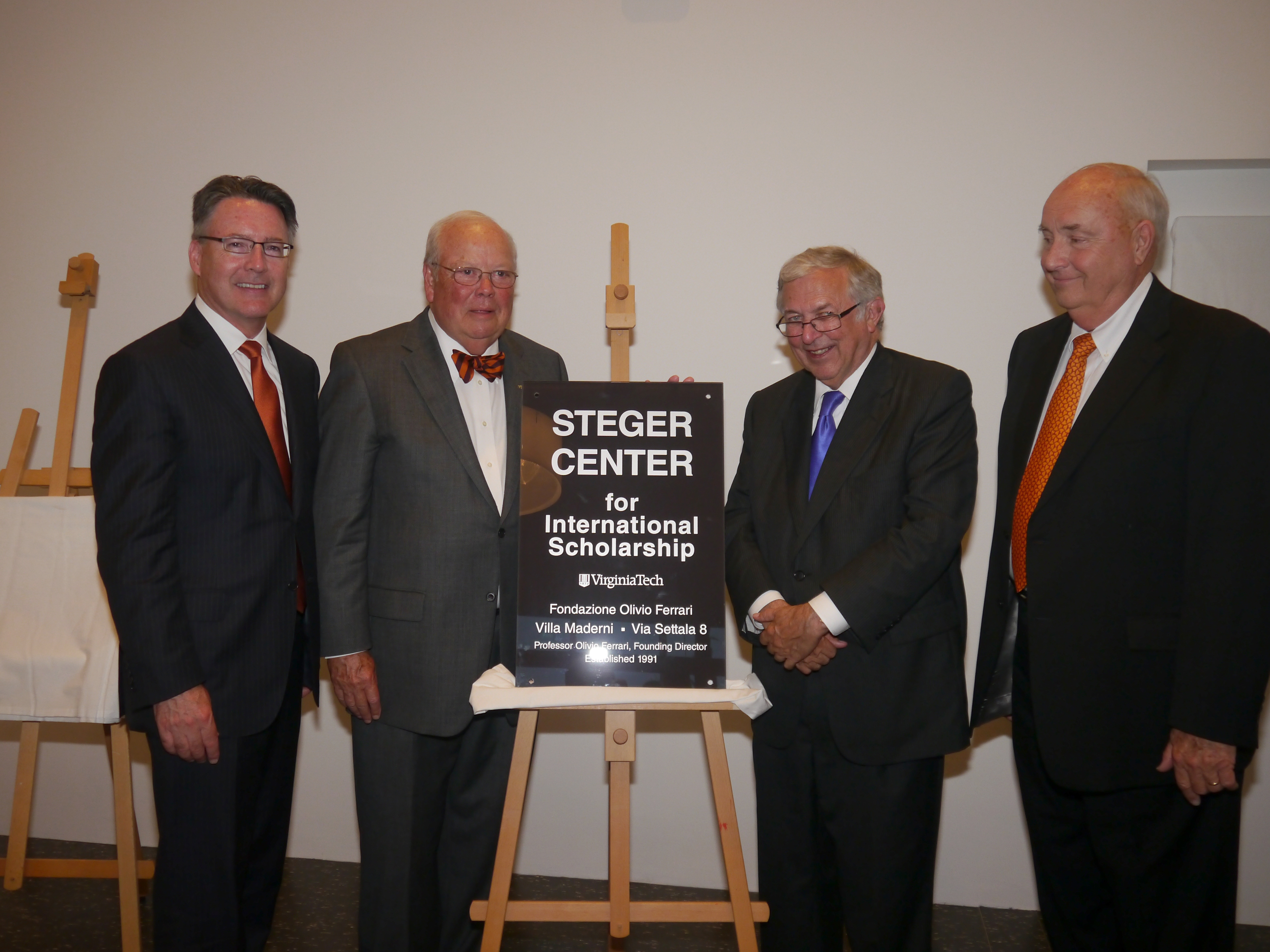 University President Timothy Sands, Virginia Tech Foundation Board Chairman Ben Davenport Jr., Former university president Charles W. Steger, and Board of Visitors member William Holtzman