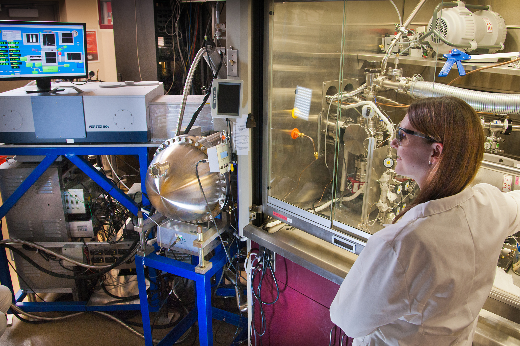 Erin Durke, a chemist with Excet Inc., works with the chemical analyzer built at Virginia Tech.