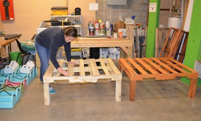 Cassidy Kees helps build furniture and repurpose donations at the Habitat for Humanity ReStore in Christiansburg, Virginia