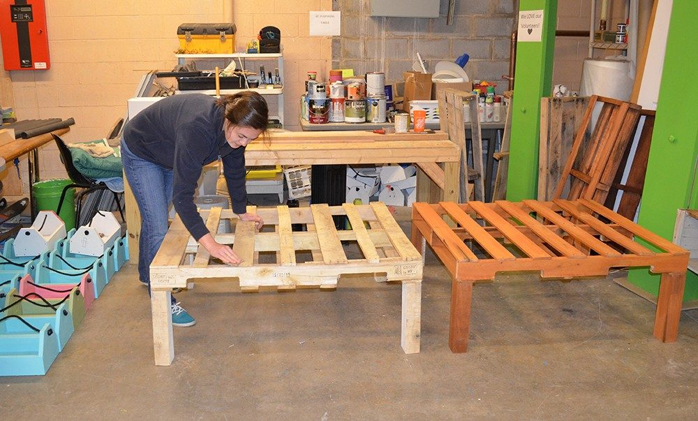 Cassidy Kees helps build furniture and repurpose donations at the Habitat for Humanity ReStore in Christiansburg, Virginia, as her federal work study job.